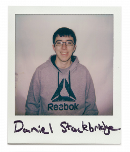 Daniel, man with glasses smiling at the camera