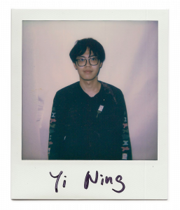 Yi, artist standing in front of the camera